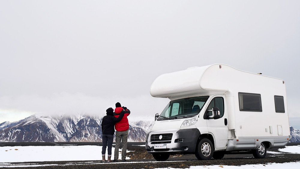Campervan in Iceland with Snowy Mountains