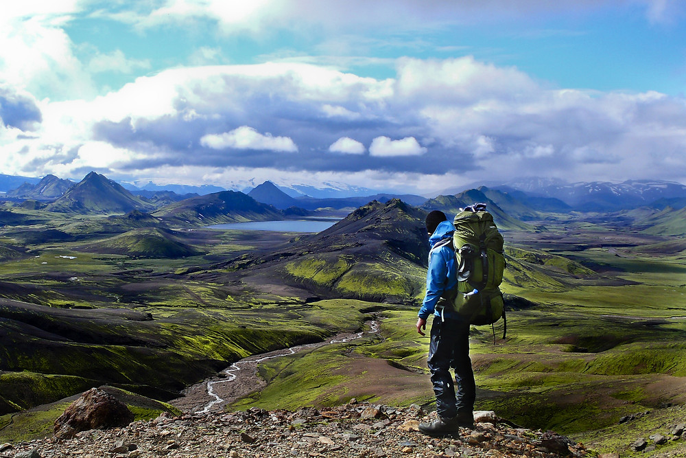 Iceland traveler with essentials packed in his backpack