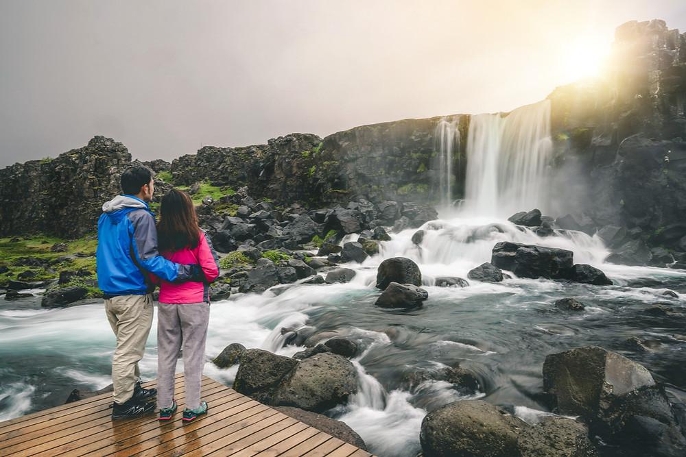 Iceland national park Thingvellir couple at waterfall