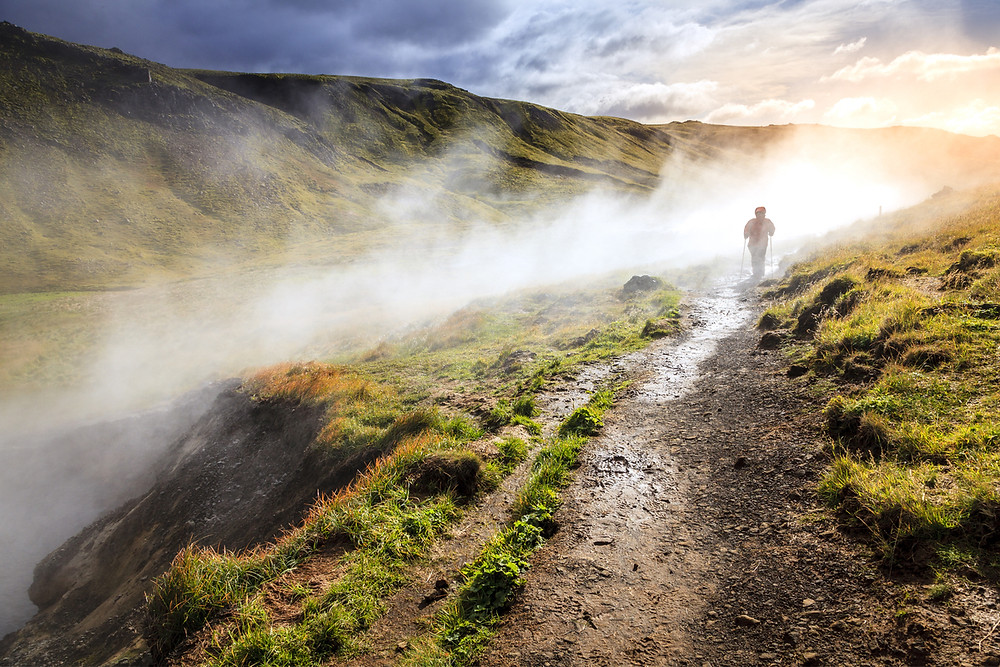 Hiker doing the hot springs hike in Reykjadalur Valley