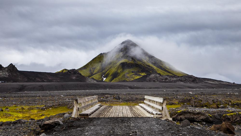 Wooden bridge on Iceland's Highlands with 4x4 camper