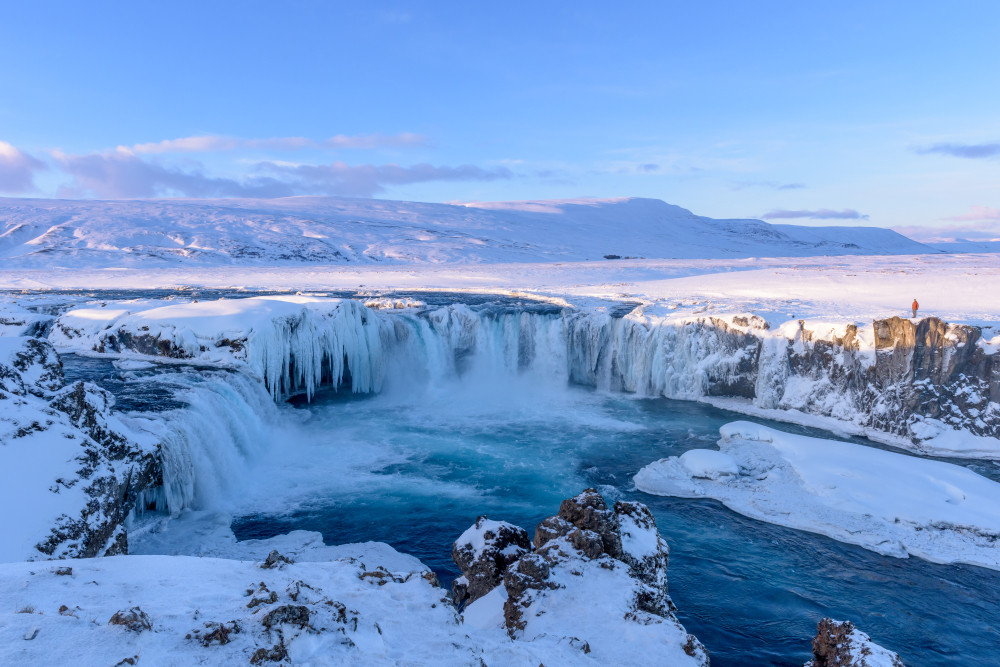 Beautiful frozen Godafoss is one of the best things to do in Iceland in winter
