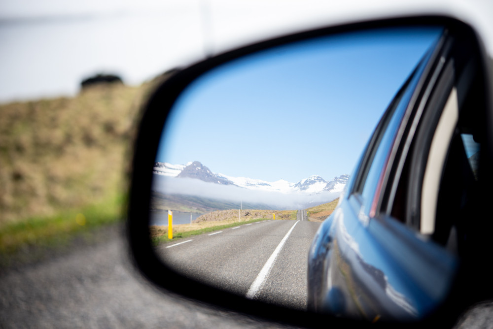 Rearview mirror landscape while driving in Iceland