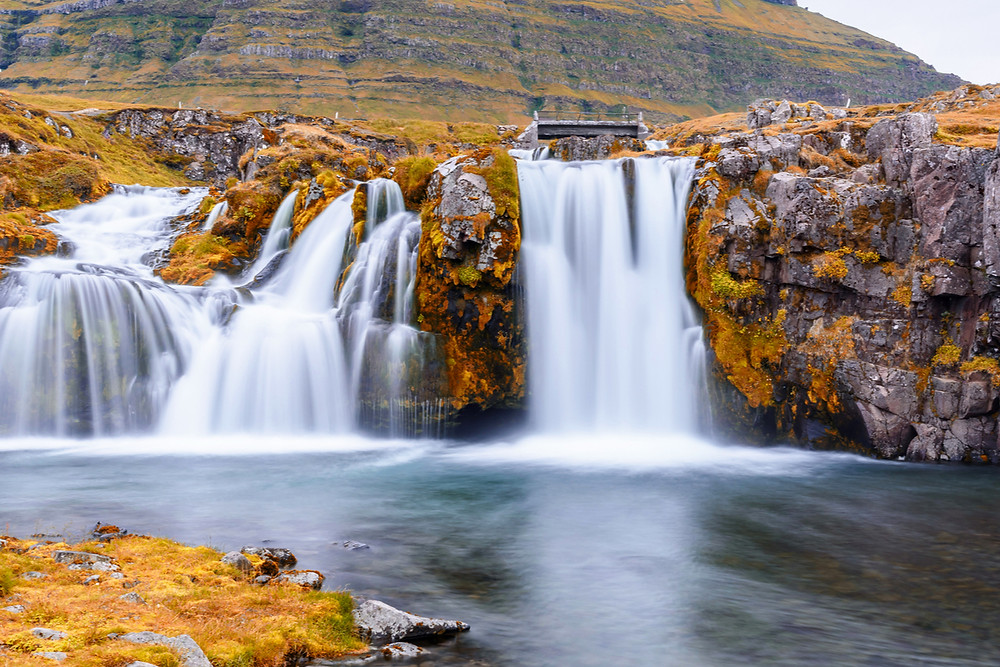 Driving in Iceland in the fall foliage and waterfall
