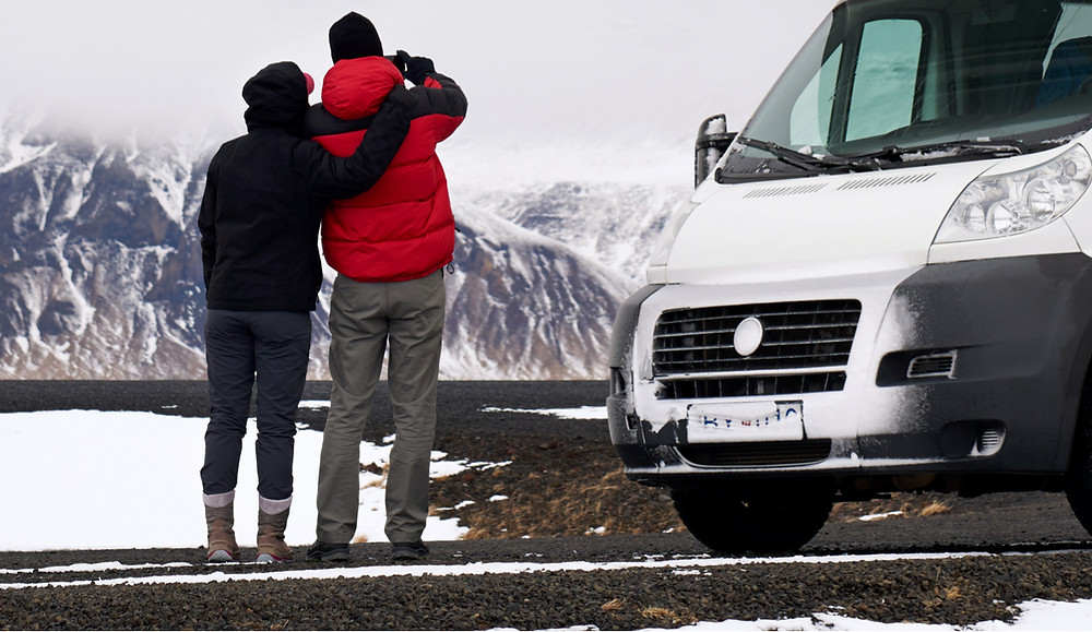 Open all year campsites in Iceland campervan and couple enjoying view