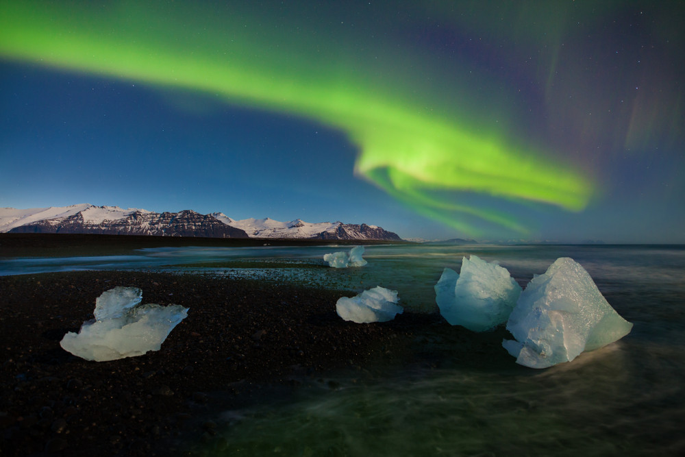 Northern Lights over Diamond Beach during Iceland road trip