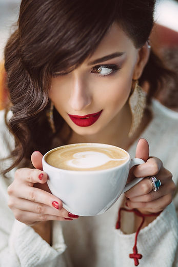 young-girl-drinking-coffee-trendy-cafe.j