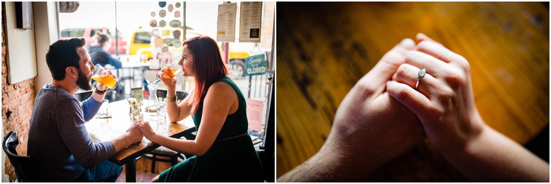 A couple sharing drinks inside the savory grain restaurant in richmond virginia