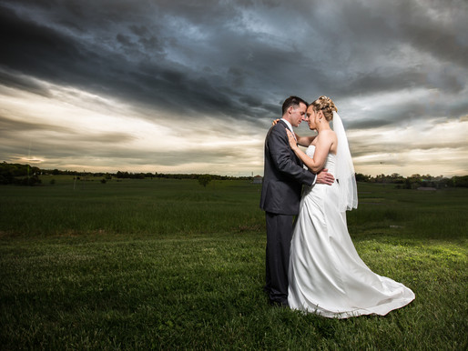 Dramatic sky wedding portrait