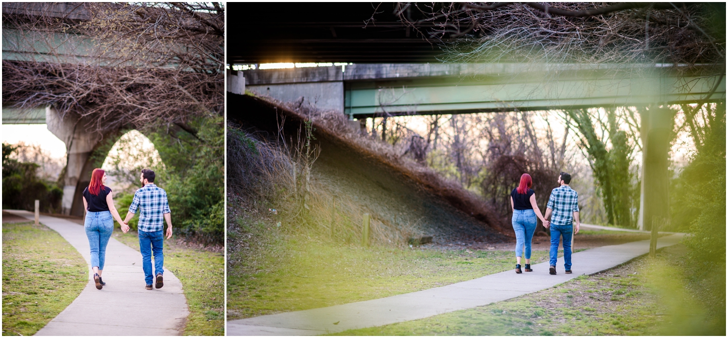 Couple walking and holding hands at floodwall park during their engagement session
