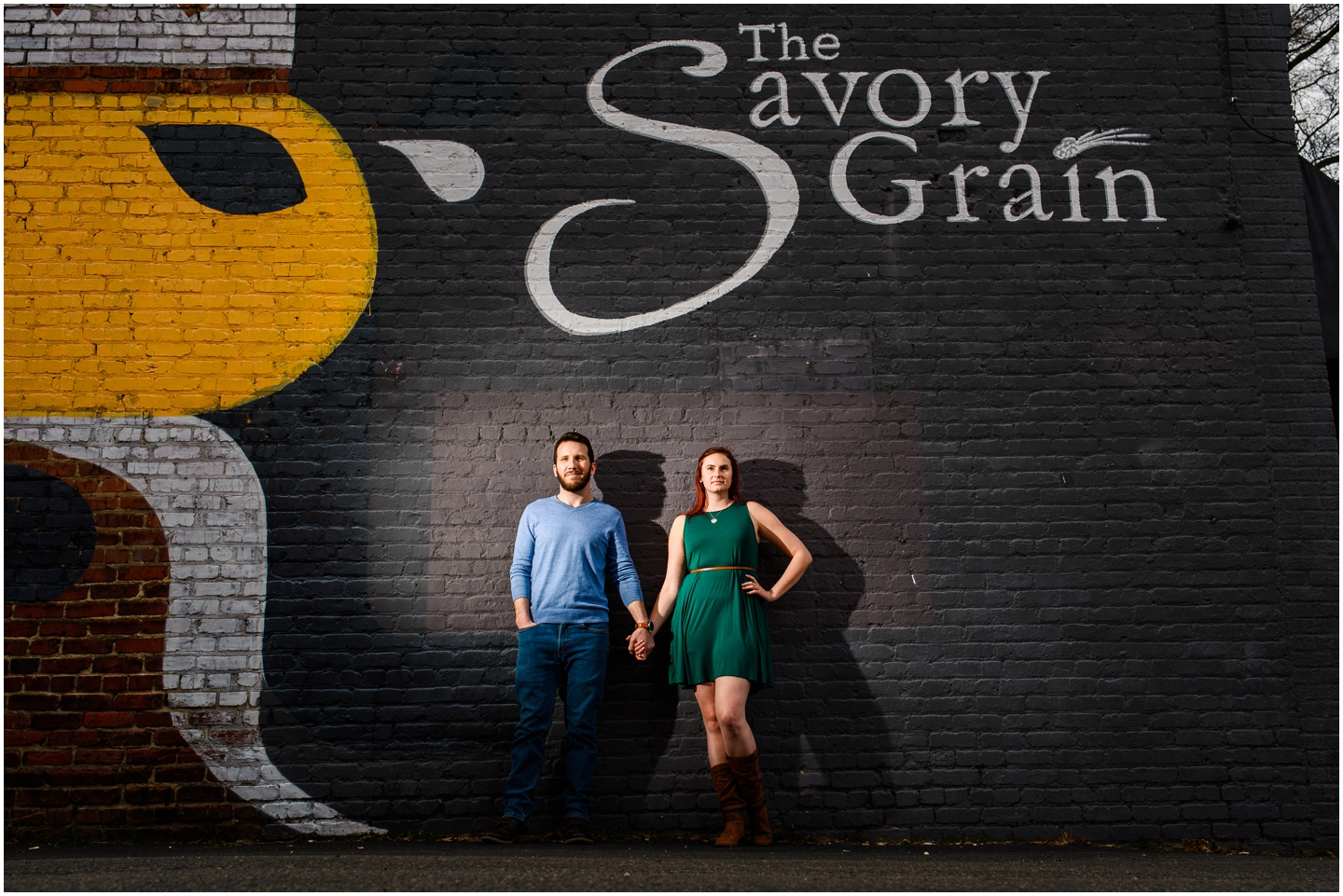 Couple holding hands during their engagement session at the savory grain in richmond virginia with off camera flash.
