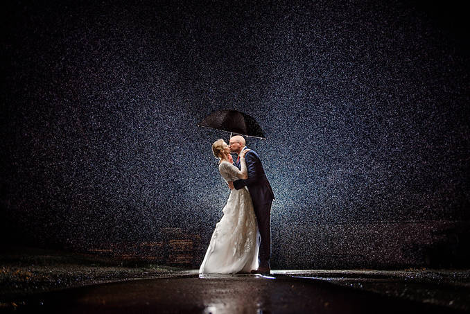 Richmond wedding photographer | Marek K. Photography | Wedding rain shot with off camera flash at williamsburg winery