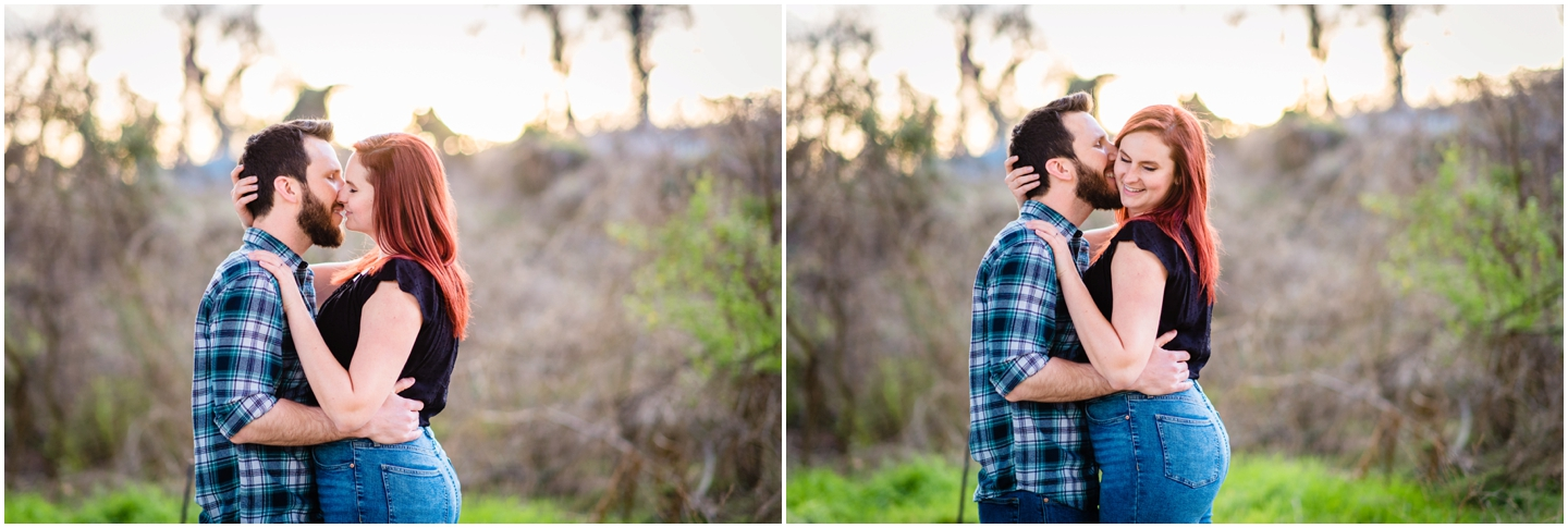 A couple embracing during their engagement session at floodwall park in richmond viginia