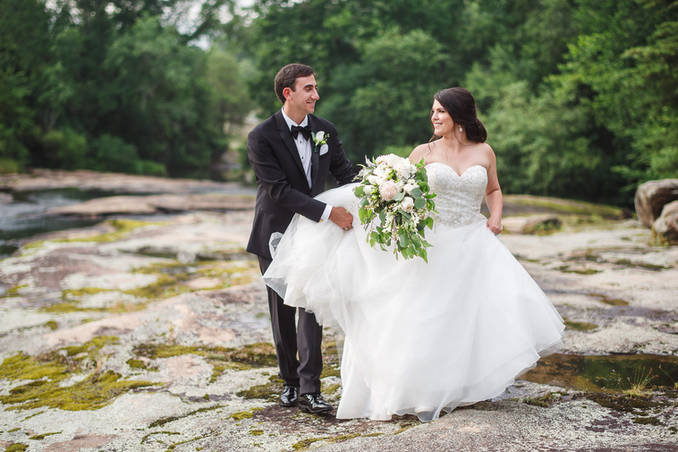 Wedding photographer in richmond | Marek K. Photography | Bride and groom walking along rocks at the mill at fine creek.