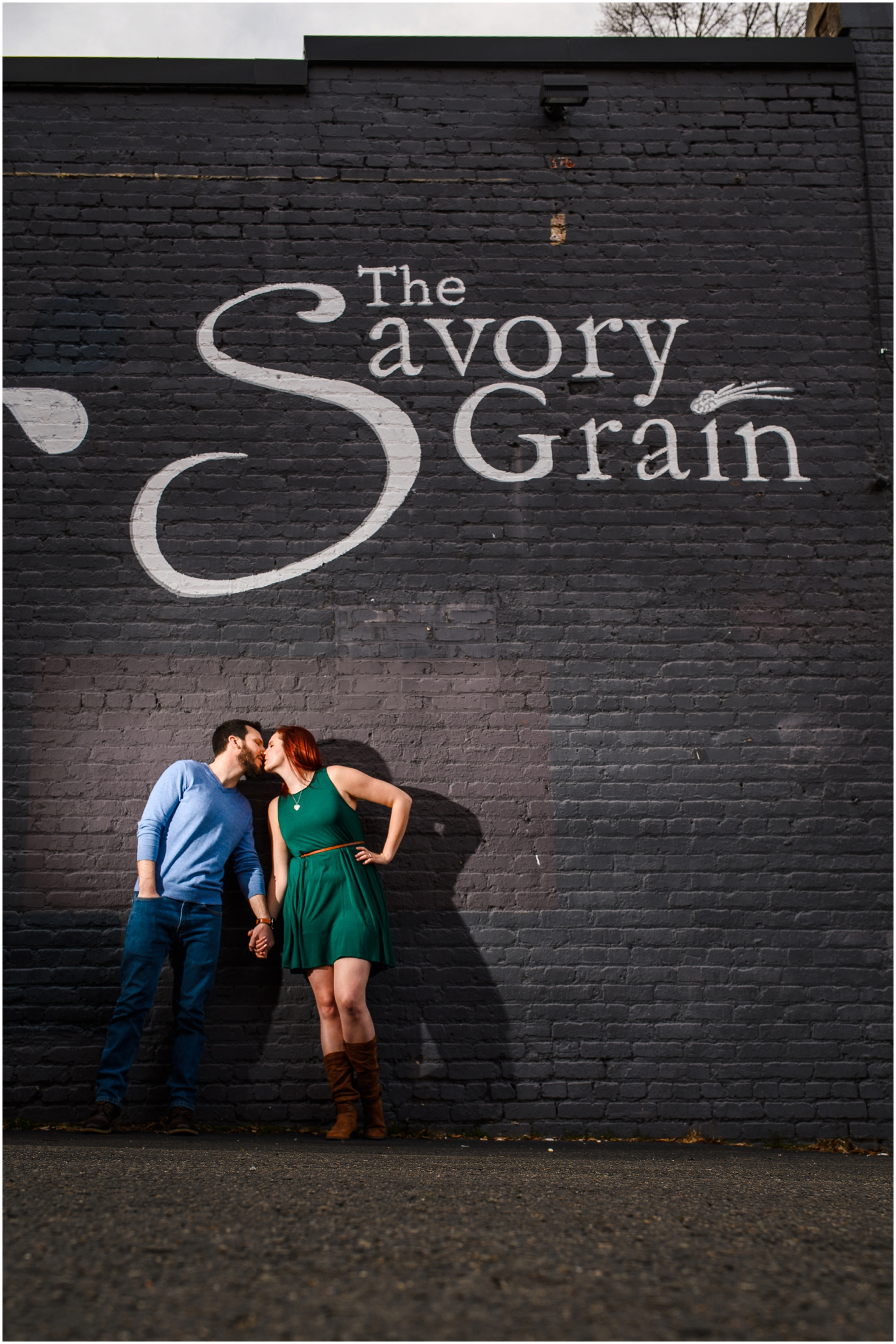 RVA engagement session couple kissing at the savory grain and floodwall park