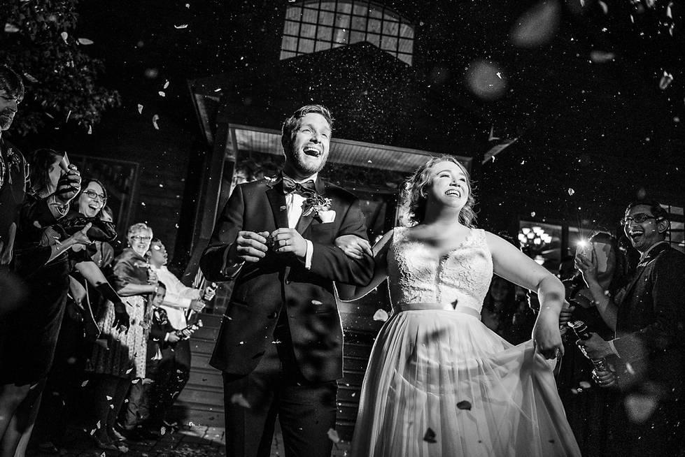 Wedding flower petal exit by richmond wedding photographer Marek K.