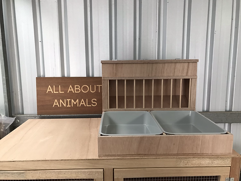 Double hay feeder and litter box combo with dowels.
