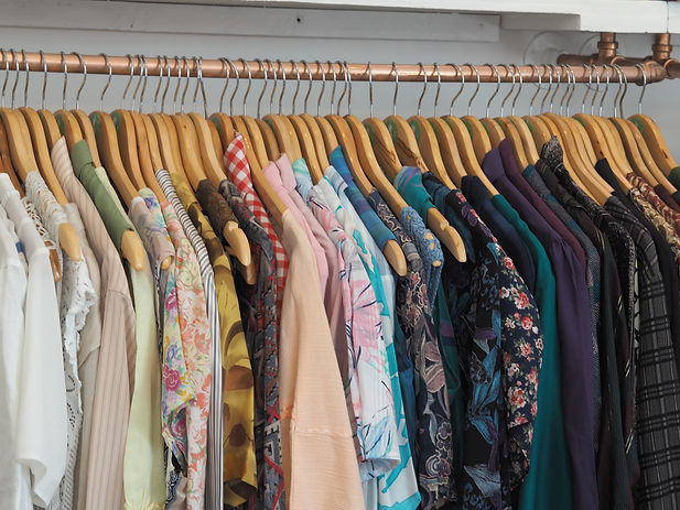 Vintage tops and blouses hanging on a clothes rail