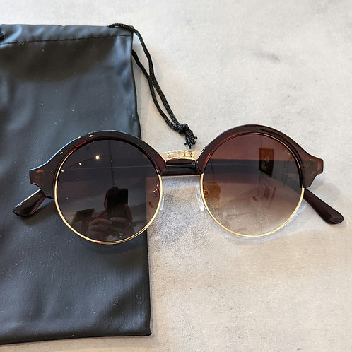 Round with gold sunglasses