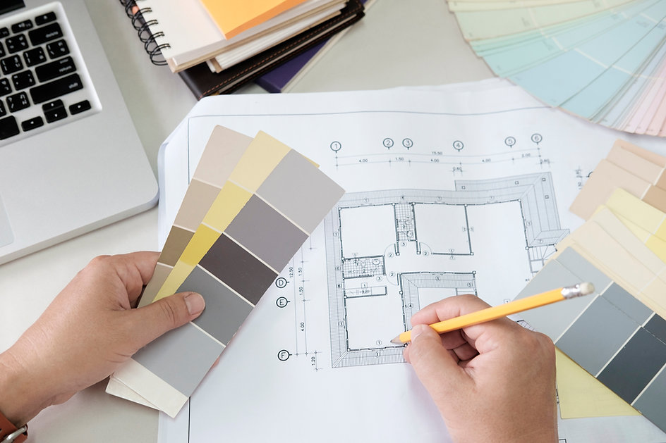 graphic-design-and-color-swatches-and-pens-on-a-desk-architectural-drawing-with-work-tools