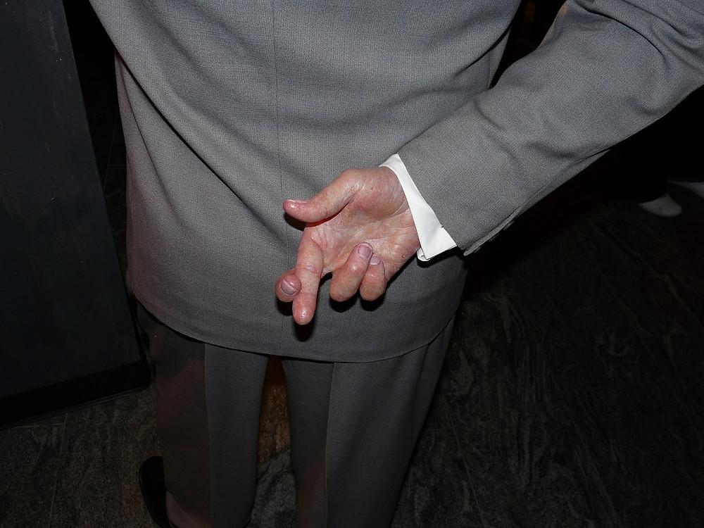 Fingers Crossed Behind Back