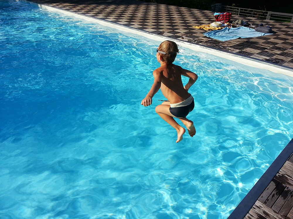 Kid Jumping in the Pool