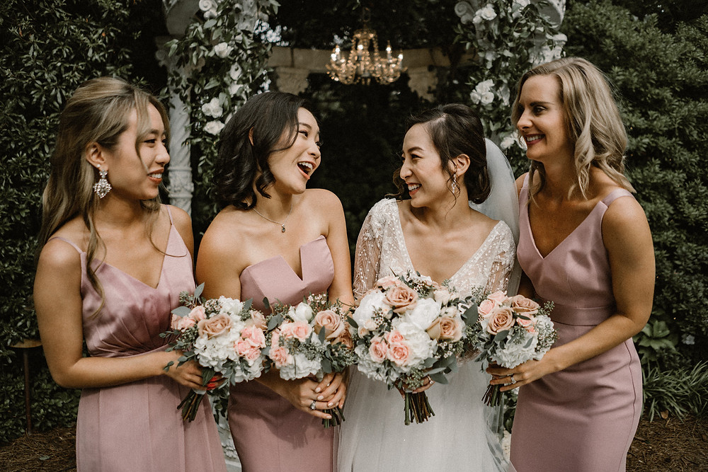 Bride with her bridesmaids wearing blush pink dresses