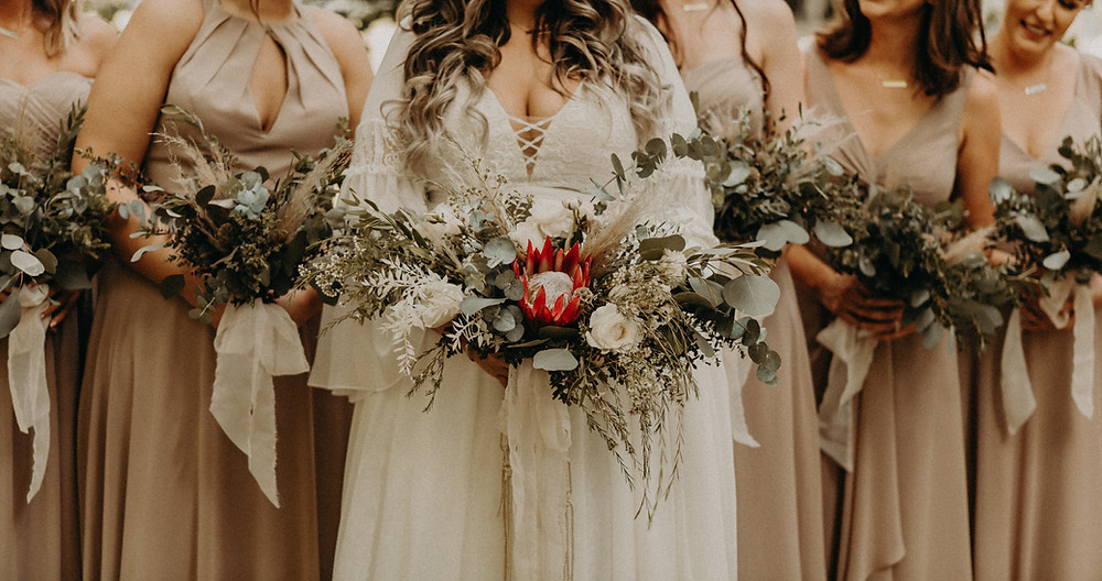 Bride and bridemaids holding bouquets