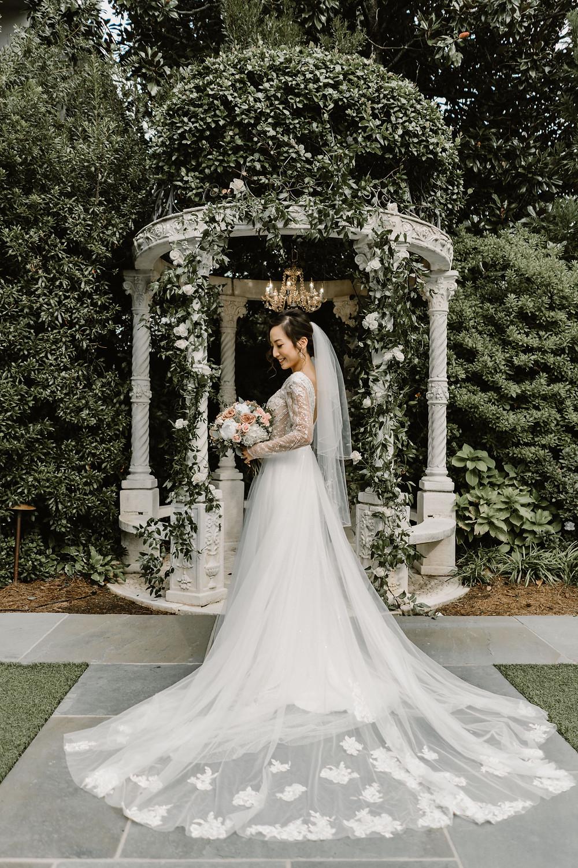 Bride wearing a tulle wedding dress in a garden