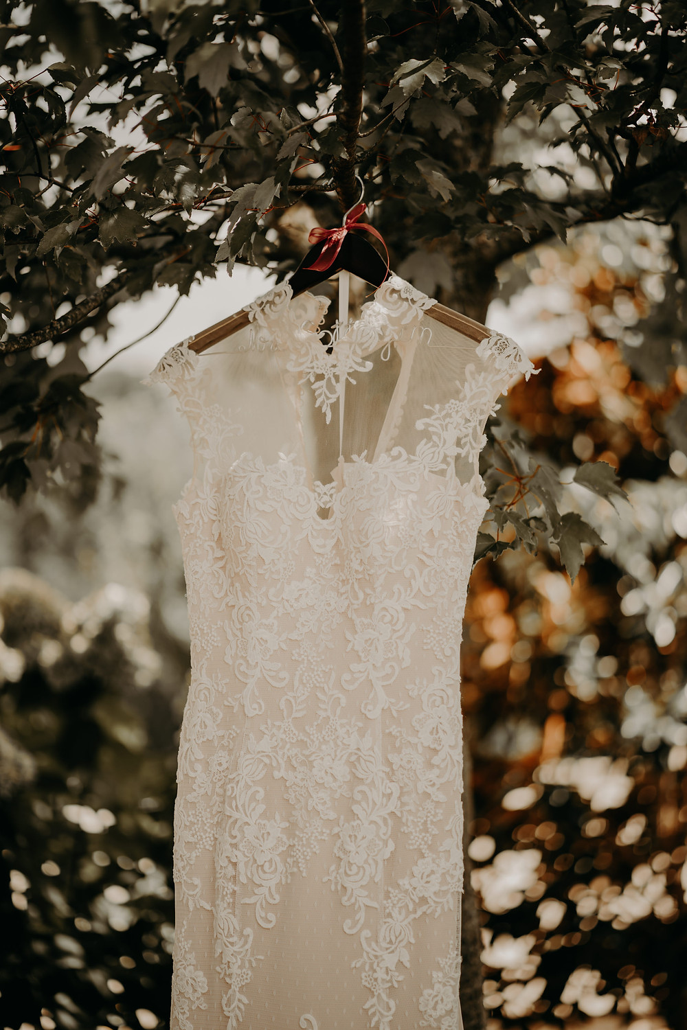 wedding lace dress in a hanger