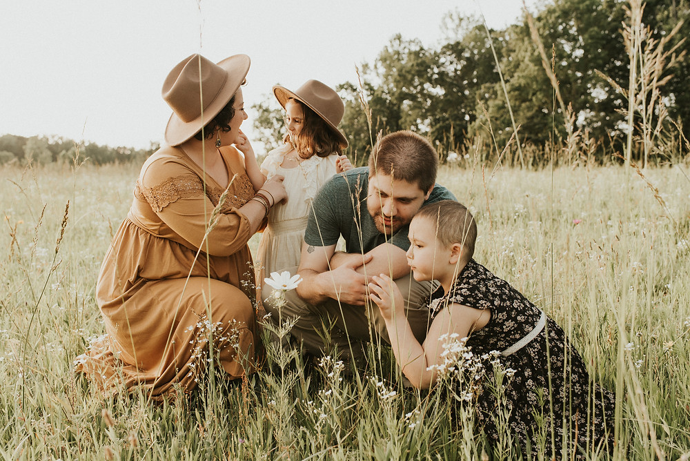 Family of 4 wearing boho clothes at a farm