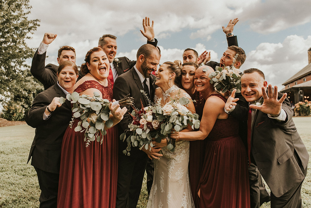 Wedding party group photo in a vineyard