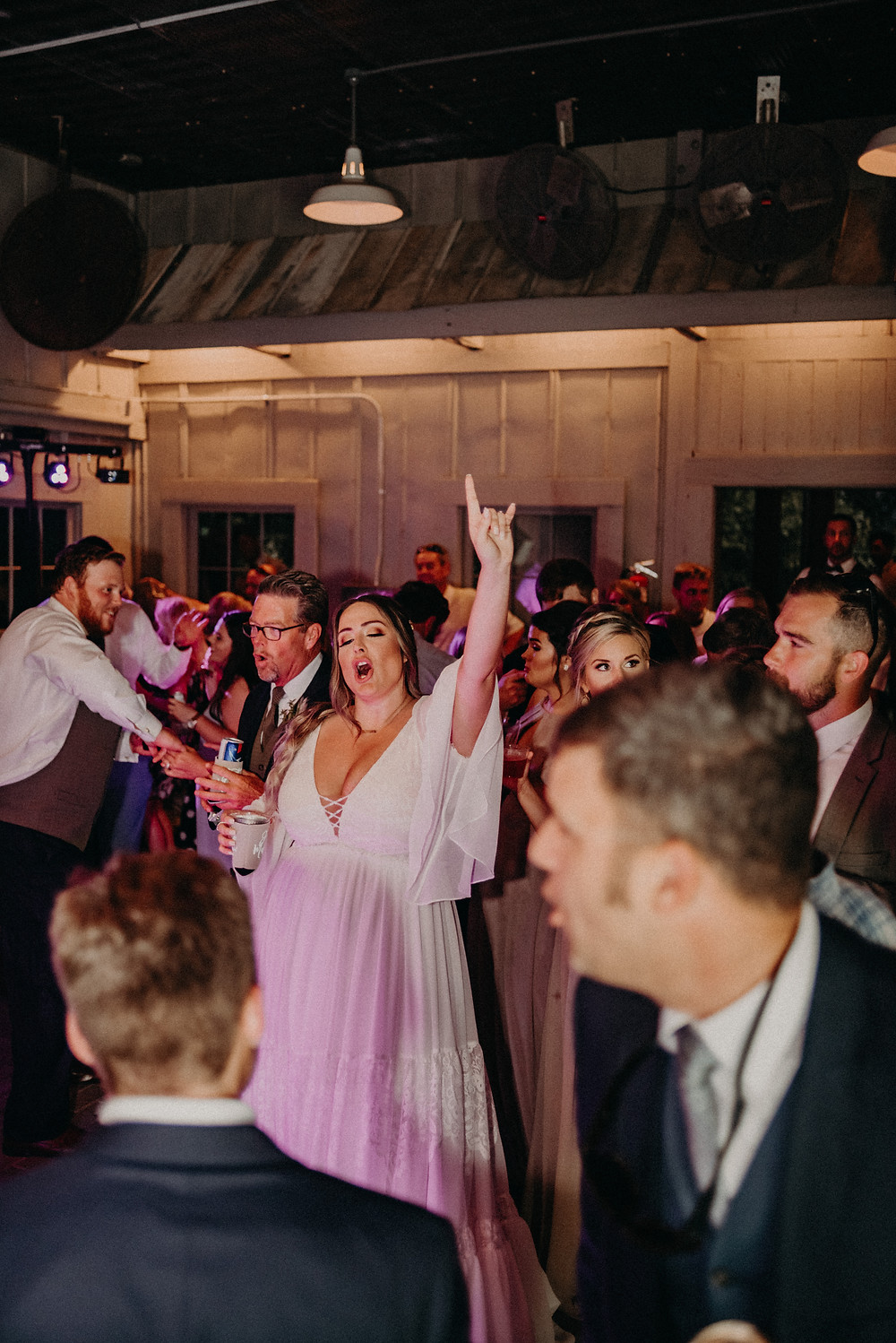 Bride having fun and singing with the guests at her wedding at Cherry Hollow Farm, GA