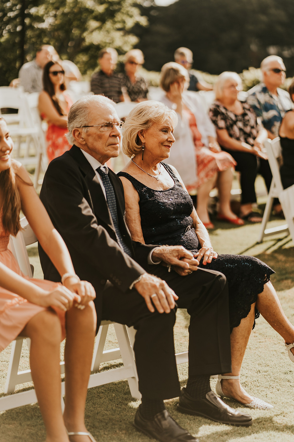 Parents of the groom watching their son's wedding ceremony