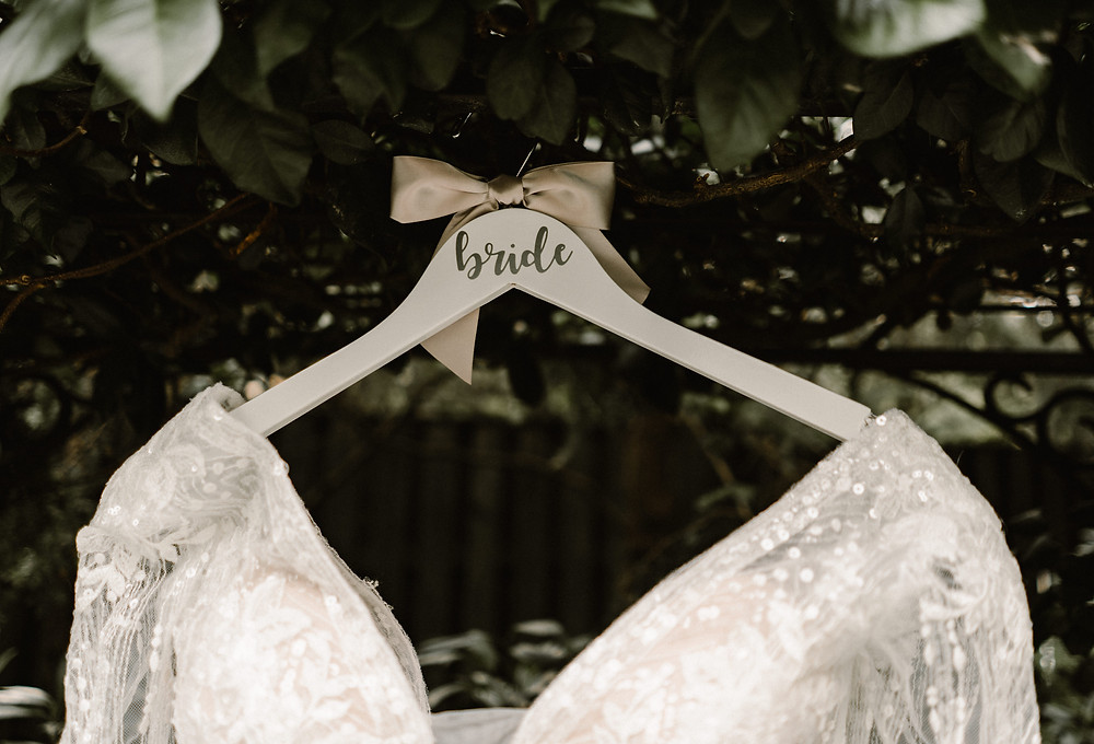 tulle wedding dress on decorated hanger.