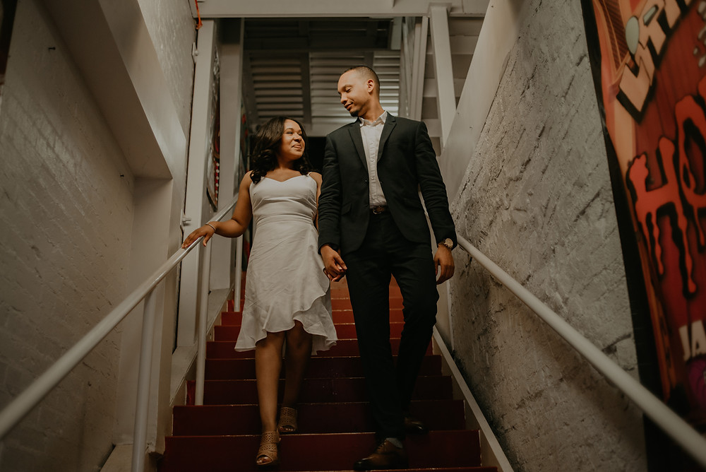 Couple walking down the stairs at their engagement session