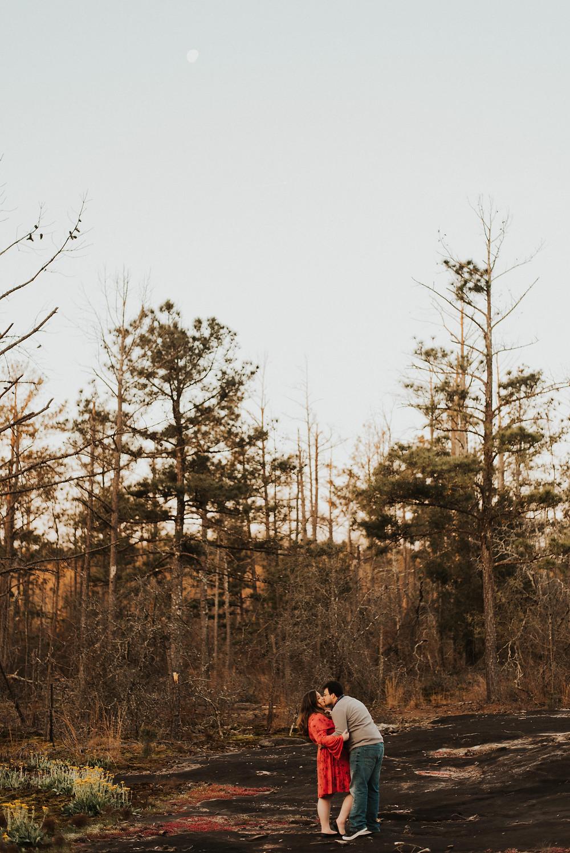 Couple Kissing. Engagement Session. Arabia Mountain. Atlanta. Georgia. Wedding Photographer