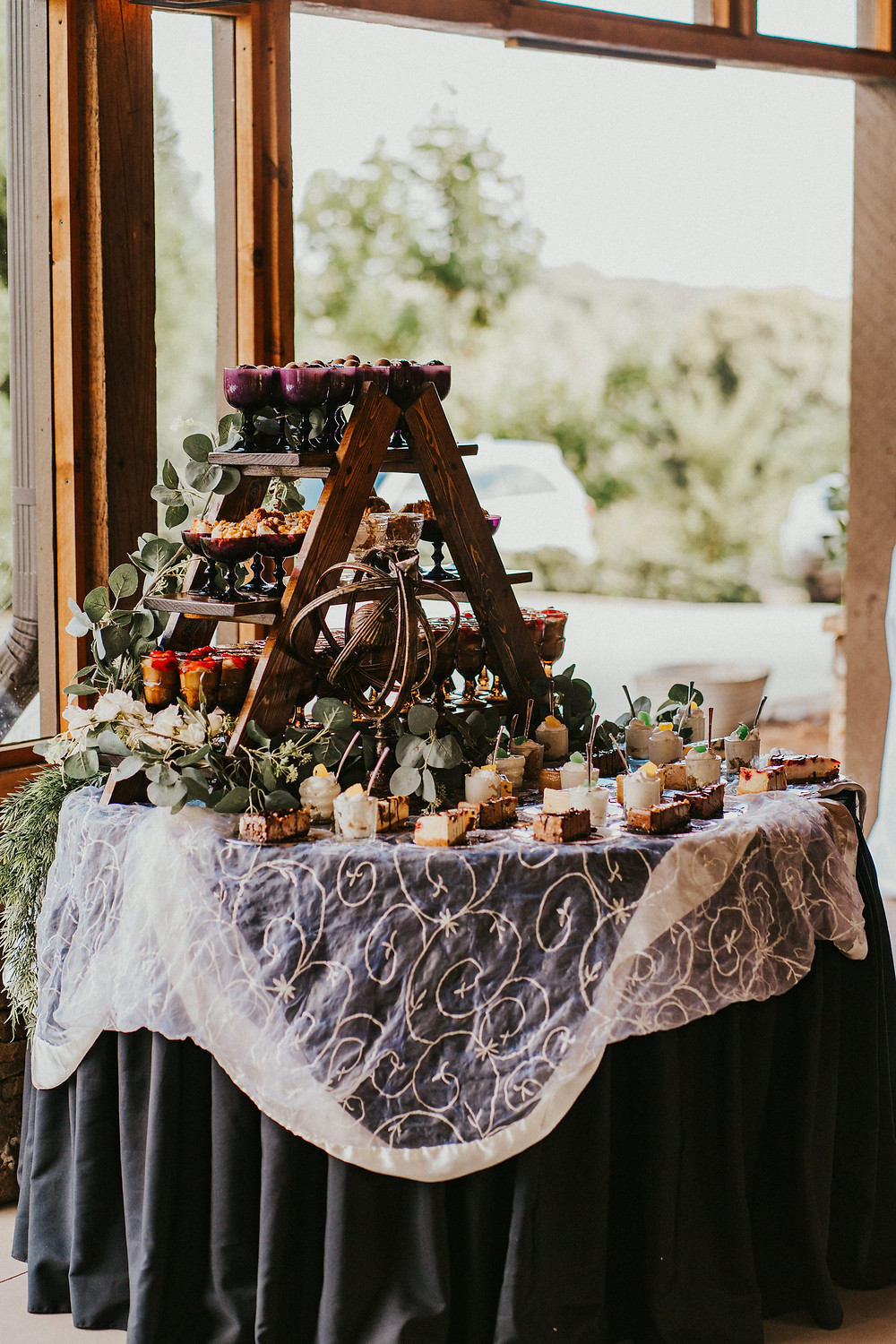 rustic vineyard wedding reception decor details, deserts station