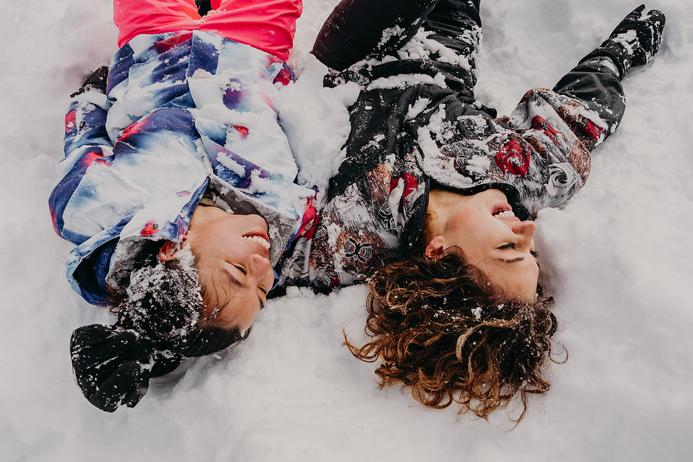 couple having fun covered in snow
