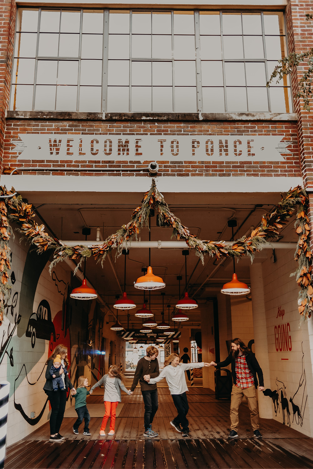 Family of 7 playing at ponce city market ga
