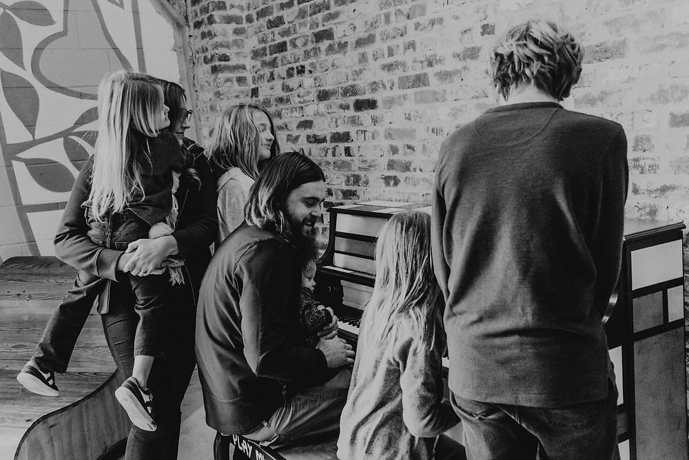 Black and white family portrait piano
