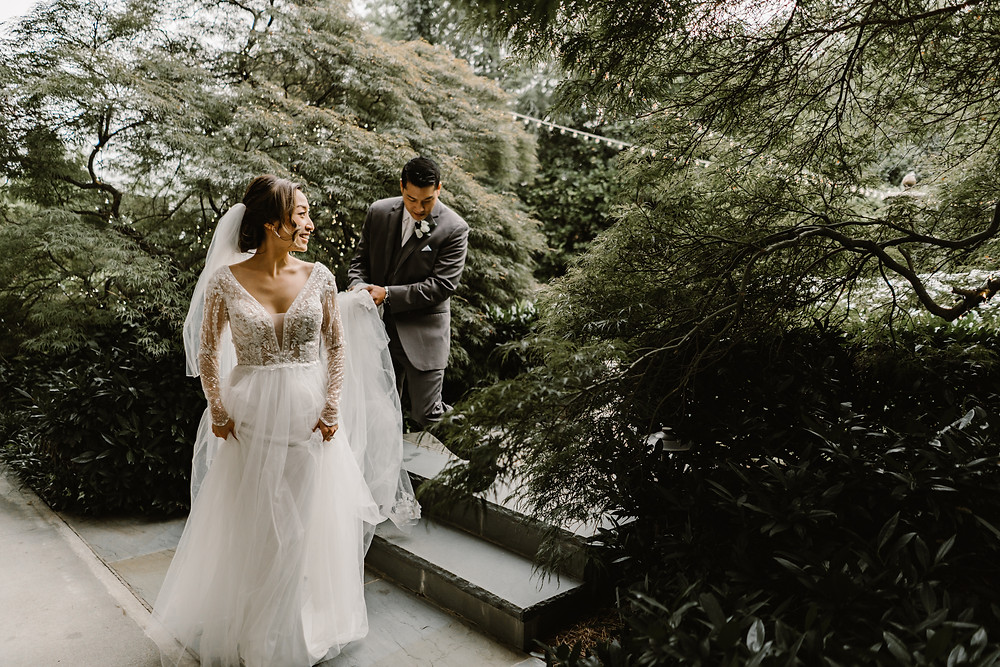 Asian couple, groom wearing a gray suit and bride wearing a long sleeved tulle wedding dress