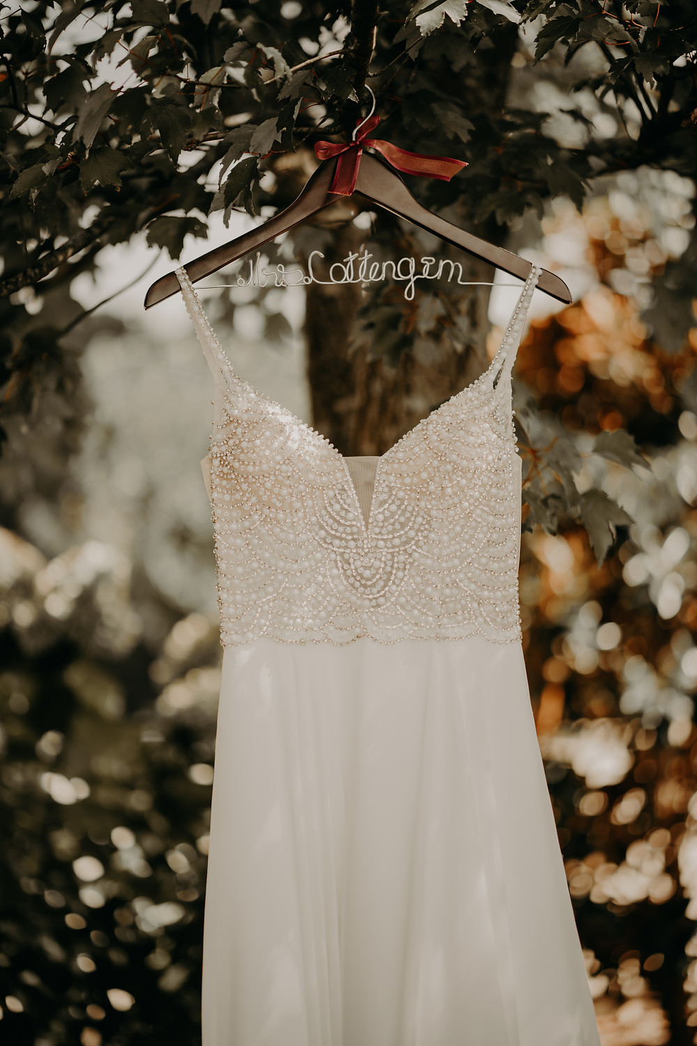 white weddibg dress with stones in a hanger