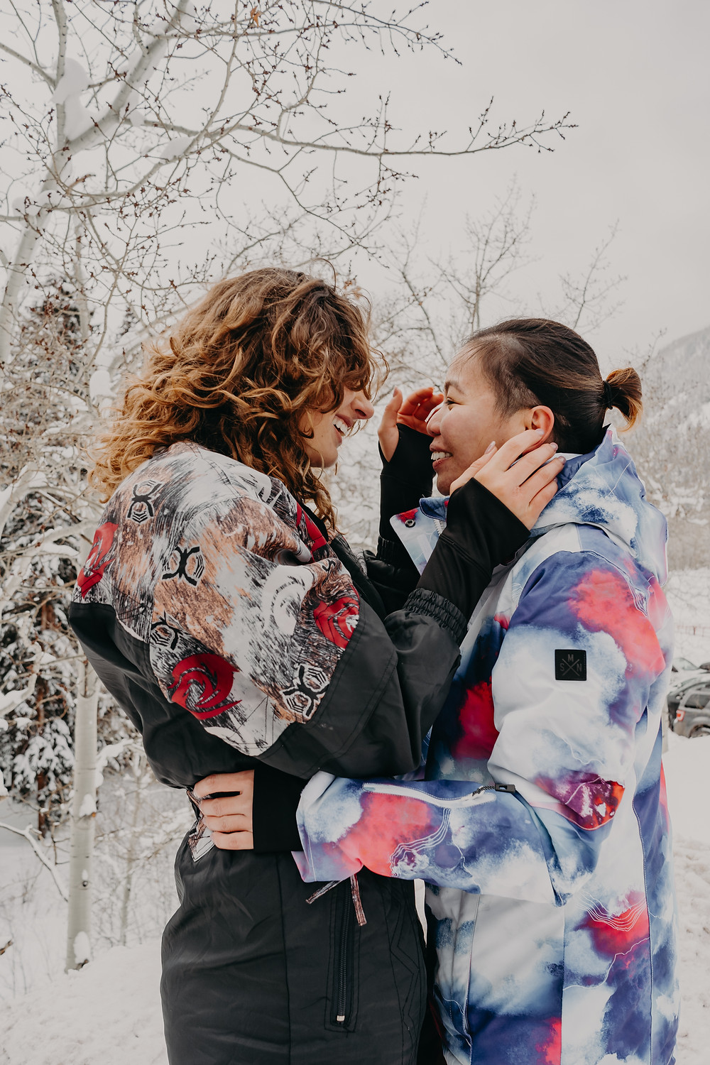 lesbian couple engagement session in colorado snow