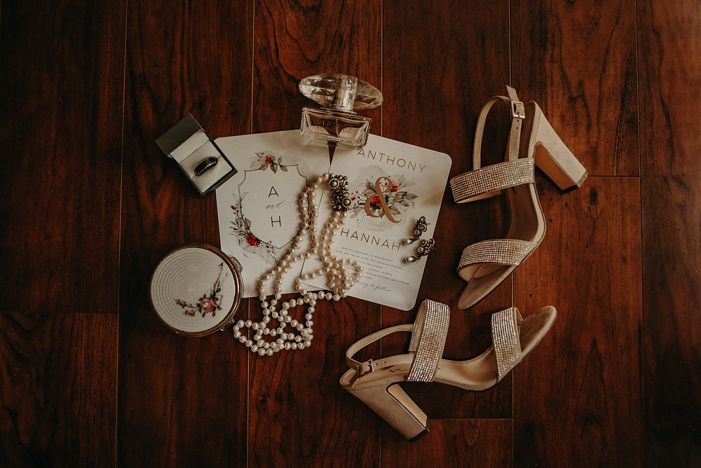 Bride's accesories for the wedding. Shoes, jewelry and perfum