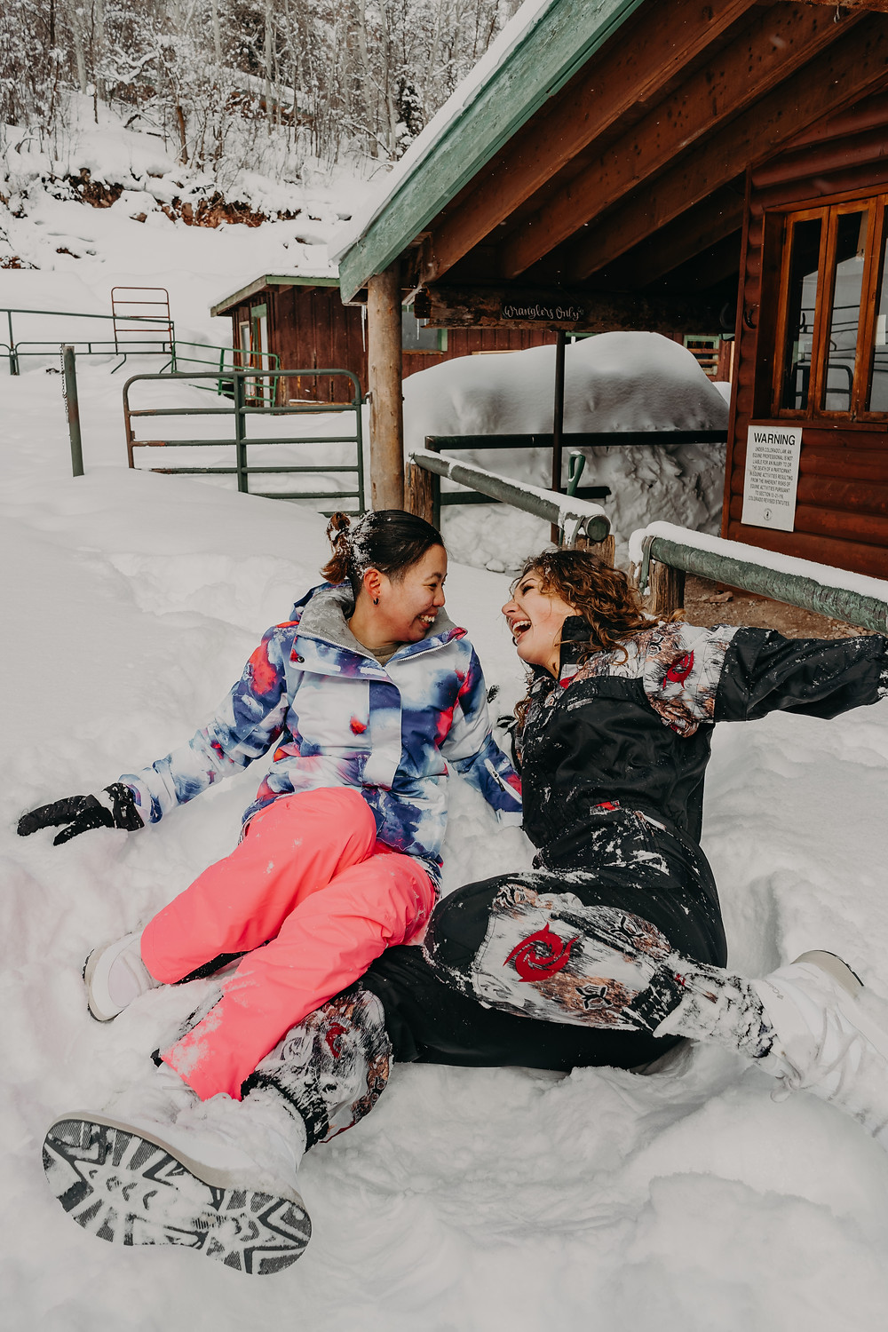 couple laughing in the snow