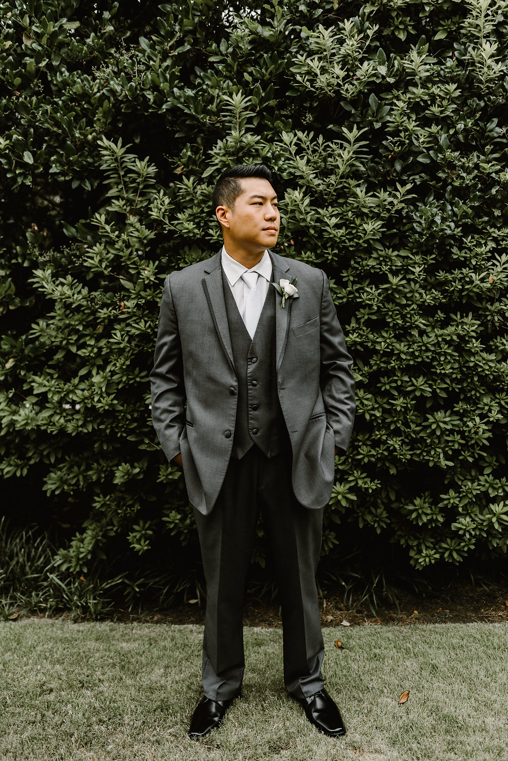 Asian Groom wearing a gray suit