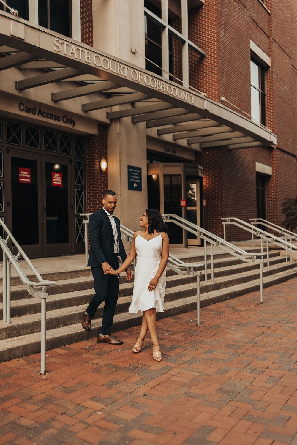 Couple's engagement session in Marietta Square, GA. State Court of Cobb County