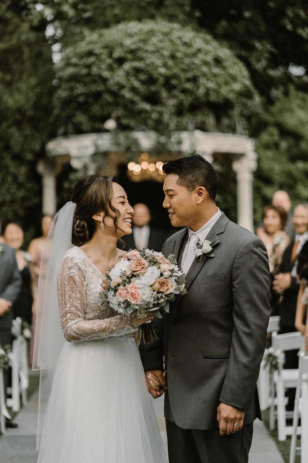 asian bride and groom smiling at each other