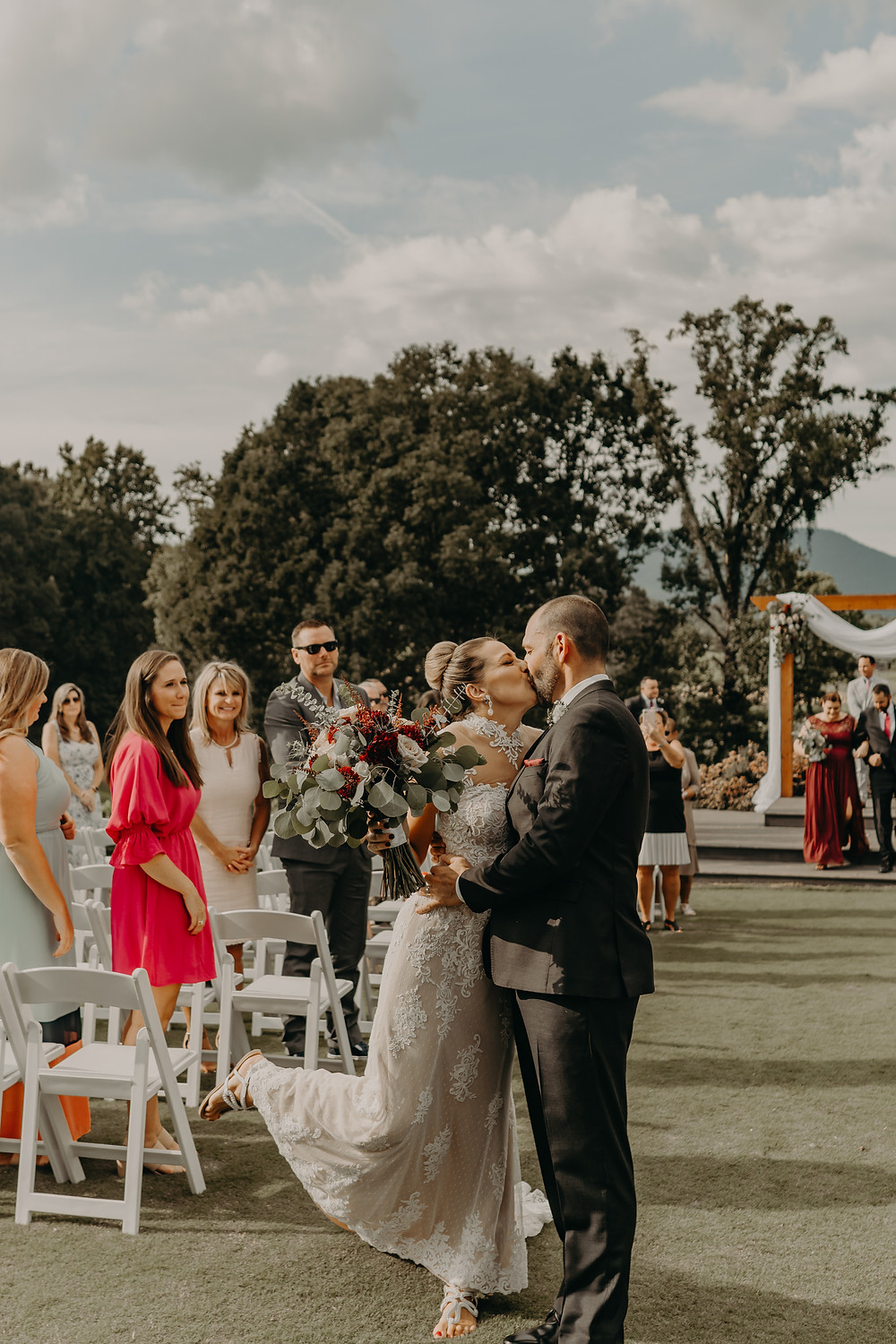 wedding ceremony in a vineyard. Couple leaving the ceremony